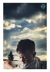 sky is our background (vikbik) Tags: sunset portrait clouds 35mm vik childportraits strobist d7000 vikbik yn560