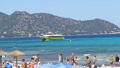 Beach and sea (Jean Bloor) Tags: hills cala majorca millor catamaranpeoplebeachseaglassbottomboatsunshineholidays