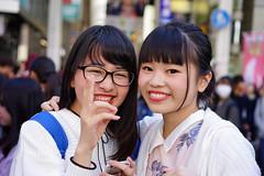 Kawaii in Dotonbori (Eric Flexyourhead) Tags: dotonbori 道頓堀 chuo chuoku 中央区 osaka 大阪市 kansai 関西地方 japan 日本 city urban street streetphotography portrait candid girl girls woman women cute kawaii かわいい smile smiling happy shallowdepthoffield sonyalphaa7 zeisssonnartfe55mmf18za zeiss 55mmf18