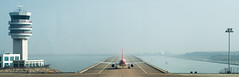 Takeoff (jgottlieb) Tags: leica mp typ 240 75mm summicron asph apo macau airport plane taking off air control tower hazy airplane water waterfront