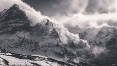 Turbulent (VandenBerge Photography) Tags: mountain nature blackandwhite mono alps europe snow clouds winter wind avalanche grindelwald berneseoberland weather season gustofwind mönch jungfrau turbulent sky switzerland cantonberne canon unescoworldheritage eiger
