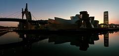 Atardecer en la ría de Bilbao (basajauntxo) Tags: reflejos reflections puente lasalve bridge museo guggenheim museum torre iberdrola tower espejo mirror ria nervion river sunset atardecer silueta silhouette bilbao bizkaia euskadi paisvasco basquecountry panorama panoramica explore