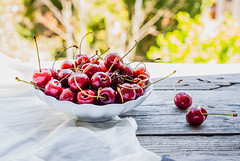 fresh red cherries in a plate, on a background of green garden, summer (harmonyandtaste) Tags: wood red summer food color tree nature closeup fruit garden cherry table dessert wooden leaf juicy healthy berry cherries raw natural sweet background rustic group tasty bowl fresh health snack vegetarian growing organic diet agriculture freshness ripe nutrition selectivefocus vitamin sweetcherriesvegan
