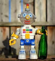 Robottle (Breeze of the Dene) Tags: robot bottle bot beer green toy pal 2 nikon df 50mm f18 garden wood wabisabi