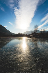 Icy reflections (Nicola Pezzoli) Tags: lago endine lake ice winter cold bergamo lombardia italy tourism colors monasterolo reflections sun light clouds