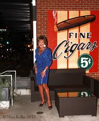 Cigar Aficionado (Miss Kellie Keene) Tags: blue woman sexy lauren beautiful silver necklace highheel dress legs sandals tan jewelry transgender bracelet hosiery earrings brunette elegant silky anklet stylish strappy hanes ninewest slingback misskellie