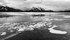 Preacher's Point, Alberta [Explored] (WherezJeff) Tags: abrahamlake alberta canada excoelis preacherspoint winter blackandwhite bubbles mood mountains overcast lake ice