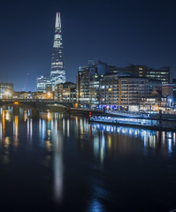 Millennium Bridge View (scott.hammond34) Tags: london cityscape nightphotography shard skyscraper skyline riverthames thames water longexposure reflection boats waterfront bridge building architecture outdoor winter canon 6d