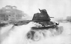 In January of 1943, a Soviet T-34 tank roars through the Square of Fallen Fighters in Stalingrad