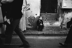 What's Going On In That Beautiful Mind (FarCorner) Tags: life street boy people festival kid alley juice expression watching historic saudi arabia photowalk jeddah curb narrow          albalad