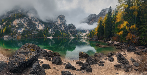Italy. Dolomites. Stone beach at lake Braies