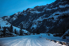 Mountain Road (wyojones) Tags: wyoming northfork shoshoneriver absarokamountains shoshonenationalforest canyon road snowcovered guardrail hiway yellowstonehighway winter evening