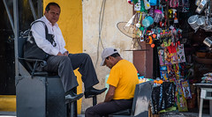 2016 - Mexico - Querétaro - Glaring Shine (Ted's photos - For Me & You) Tags: 2016 cropped mexico queretaro santiagodequeretaro tedmcgrath tedsphotos tedsphotosmexico vignetting nikon nikonfx nikond750 people peopleandpaths satchel males frown shoeshine ballcap handbag shoes seated seat sitting