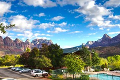 From the balcony of a motel in Springdale, UT looking north to the southernmost end of Zion NP (Herculeus.) Tags: beehives bouldersstonerocks buildings clouds country day fall fences hotelsinnslodges landscape landscapes majesticviewhotelspringdaleut mountains mountainside outdoor outdoors outside peaks rockoutcrop rockwall sky sun swimmingpools trees ut valley zionnp