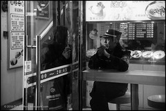(teknopunk.com) Tags: asian groupofpeople restaurant film onewoman lenstagok guard talking photography location chinese c yellowfilterbwe4050222x asia g 50f15carlzeissjenasonnartltm1941nr2725033 u shanghai blackwhite monochrome glassdoor uniform r leicammonochromtyp246sn4963868 t throughglass people o china blackandwhite chatting gear oneman 50mmlens