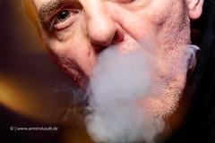 close up portrait of a smoking man (Armin Staudt) Tags: man black blur macro male closeup mouth studio cool healthy technology hand cigaret
