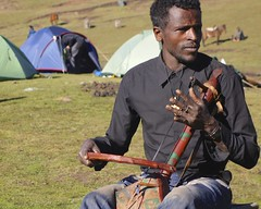 Village Music Man Tracey Croke (www.secretcompass.com) Tags: travel music mountain man mountains expedition bike trek track peak hike adventure explore single cycle biking mtb summit local ethiopia exploration epic pioneering simien worldfirst rasdashen secretcompass traceycroke achievetheextraordinary richardwainhobson