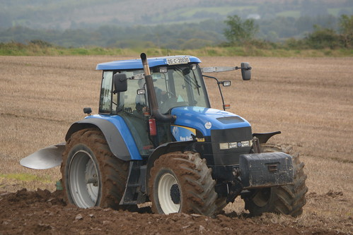 New Holland TM190 Tractor with a Kverneland 5 Furrow Plough