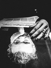 on the other hand (matthias hämmerly) Tags: switzerland world street photography shoot black white bw candid going collecting story faces journalism real honest moments decisive moment creative ricoh gr2 gr christmas hand ring newspaper hands nail woman girl reading train