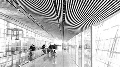 In between stops (B Bessim) Tags: airport beijing china building architecture timber beams glass windows light lines people perspective reflections
