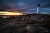 After the rain shower (Nancy Rose) Tags: lighthouse peggyscove atlantic 7439 waves sunset rocks clouds weather nature tourism