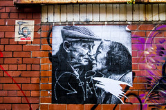 monochrome love on the wall (PDKImages) Tags: posterart manchesterstreetgallery manchesterstreetart art artinthecity love walls bee doorways men eyes wall mural couple industrial hidden beauty message hiddenart urbanart