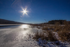 Flaring Sun Over The Basha Kill (John Kocijanski) Tags: sunflare sun sky wetlands bashakill winter snow ice landscape canon1022mmlens