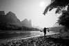 Pole carrier. (Pierre Bodilis) Tags: blackandwhite china lijiangriver river silhouette xingping guilinshi guangxizhuangzuzizhiqu cn