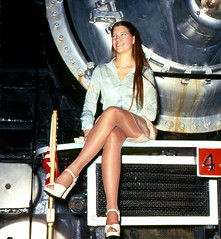 Perched, 1977 (clarkfred33) Tags: americanfreedomtrain sp4449 daylightlocomotive southernpacific 1977 vintagephoto historicphoto sanford aft pose pantyhose flashphoto nightphoto historic sphistory classy classylady famous railroadadventure glamour