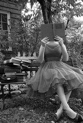 Book lady (kevin63) Tags: lightner photo old vintage antique blackandwhite woman gun books frilly beehive bench outdoors reading hiding face purse black