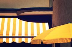 yellow (Rino Alessandrini) Tags: giallo tende geometrie urbano dettagli forme colori astratto tendone ombre bianco ocra tessuto muro ruvido stoffa ombrellone yellow tents urban geometries shapes colors abstract details tent shadows ocher white wall rough fabric cloth umbrella