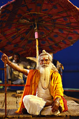 Baba by the ghat (kissoflif3) Tags: baba sadhu varanasi india street umbrella ganga ganges ghat banaras evening bluehour indian oldman