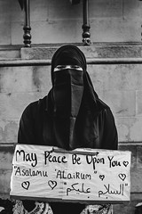 Trump protest London (ChrisJWake) Tags: london londoncity london2017 westminster whitehall street streetphotography streetlife urban blackandwhite blackwhite bnw monochrome muslim muslimban hijab burka niqab headwear scarf clothing photojournalism photojournalist nikon d4s nikkor 35mm 35mmf14g closeup people love peace religion trump dumptrump trump2017 donaldtrump portrait portraiture