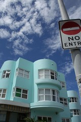Corner of Brighton Blvd (kelpenhagen) Tags: blue red beach bondi tag3 taggedout clouds aqua tag2 tag1 streetsign curves sydney australia bluesky stopsign nsw artdeco deco bondibeach whatsthatbluethingdoinghere brightonblvd northbondiinterchange postyle top20sydney