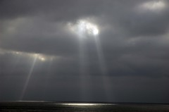 breaking through (DeeperSea) Tags: ocean light sea sky sun storm clouds dark rays sunrays beams sunbeams godlight