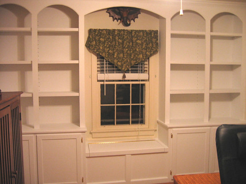 Surrounding a window with a bookcase on both sides is a great use of space,