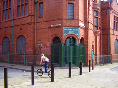 Salford Lads Club Girl (Neil101) Tags: 2005 street old uk red england building brick girl up bike architecture club manchester lads morrissey north neil northern salford smiths edwardian coronation thesmiths wilkinson neilwilkinson neil101 bbcmanchesterblog