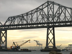 moving - static (pbo31) Tags: sanfrancisco california new city morning bridge red urban wet weather northerncalifornia grey oakland bay march construction tour lift traffic crane citylife 2006 tourist rainy baybridge sanfranciscobayarea bayarea sanfranciscobay rushhour eastbay 80 californian caltrans baycity sanfranciscobaybridge tollbridge eastbaybridge highway80 sanfranciscan citybridge transbaybridge overthebay