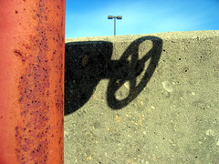 wheel shadow (JKnig) Tags: blue shadow red sky abstract metal tag3 taggedout concrete tag2 tag1
