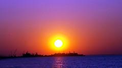 Sandy Hook Sunset (Sister72) Tags: pink blue sunset sky orange sun water beautiful yellow clouds sunrise star bay soleil dusk space navy nj lavender ciel astronomy universe nuages sister72 espace sandyhook solarsystem earle coucherdesoleil leverdesoleil étoile astronomie univers forthancock systèmesolaire