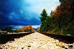 The Road Leads Where It's Led (MonsieurPi) Tags: sky tree nature stone clouds 1025fav 510fav landscape lomo lca xpro xprocess railway 100v10f lomolca xprocessed