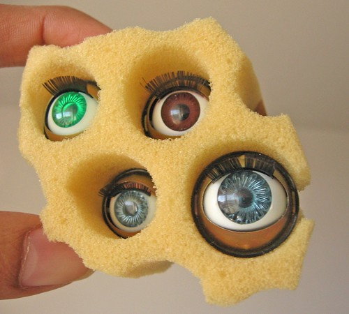 Sponge to look like Swiss cheese with eyes on it