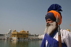 Nihang Warrior at Golden Temple, India (Captain Suresh Sharma) Tags: blue portrait sky india holiday colour art heritage history saint metal hair beard religious soldier necklace costume shrine asia fighter spirit traditional faith religion culture happiness oldman holy sacred sword warrior brave colourful turban sikh tradition ornate punjab spiritual devotee insignia ethnic amritsar baba conventional gurudwara pilgrim bold goldentemple punjabi saffron ethnicity spear holyman singh panjabi headgear pious godly attire kirpan saintly sanctity panjab nihang devoutee weaopn sewadar lifestyle