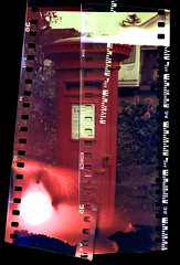 Last Collection (alspix) Tags: red letterbox agfaclack sprocketholes redscale novaprospeedc41 filminbackwards