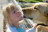 Cuteness. (paigelynn) Tags: dog pet pets dogs girl tongue tag3 taggedout kids canon children kid interestingness tag2 tag1 child daughter interestingness1 2006 lick carrie rumsfeld soe sspets onetopfave i500 top20cute paigelynn thebiggestgroup explore19apr06 ©paigemandera tbgc2 diamondclassphotographer