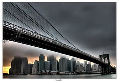 Dark City - from Dumbo (Arnold Pouteau's) Tags: nyc newyorkcity sunset newyork brooklyn manhattan dumbo brooklynbridge gotham f25 cloudydowntown