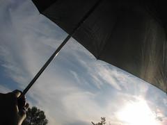 under my umbrella.... (nalakuvarah) Tags: sky nubes paraguas rayosdesol