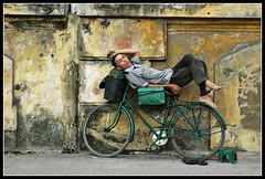 chillin (jaymce) Tags: street sleeping topf25 bicycle topv2222 topf50 topv555 topv333 topf75 topv1111 topv999 streetscene chillin dude vietnam topv5555 walker topv777 hanoi topf125 topf150 topv3333 topv4444 topf100 topf250 topf200 jaymce abw topf175 1500v60f nikonstunninggallery 3000v120f cowboynealutatafeature angkorsingle 1000v40 abigfave artlibre magmag aplusphoto top20travelportraits