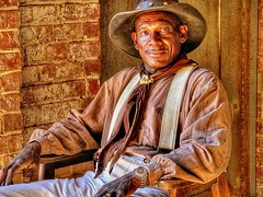 The Cowhand (Seated) (David Kozlowski) Tags: beautiful cowboys portraits bravo cowboy all texas photographer watches unique rights reserved fortworth awardwinning distinctive stockyards ©david kozlowski explore14may06 dallasphotoworks davidkozlowski dallasphotoworkscom dallasphotographer fortworthphotographer westandclear
