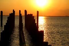 Sunset... (Flutterbye_856) Tags: sunset nature water reflections ilovenature mobilebay oldpier canonpowershota620 specnature